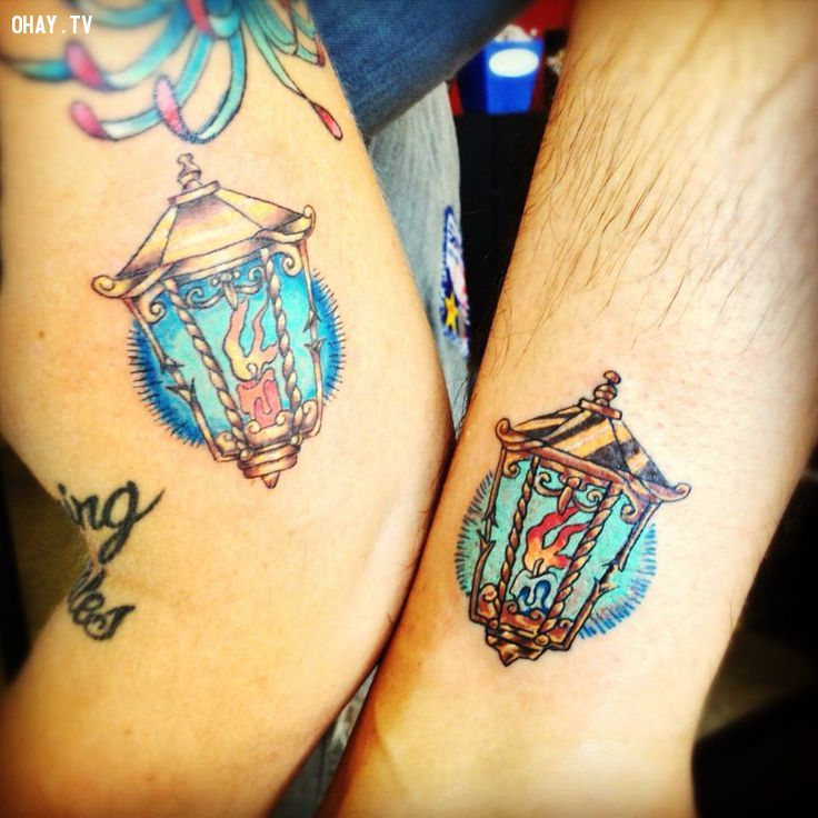 matching candle lamp tattoos for couples | InkedWeddings.com