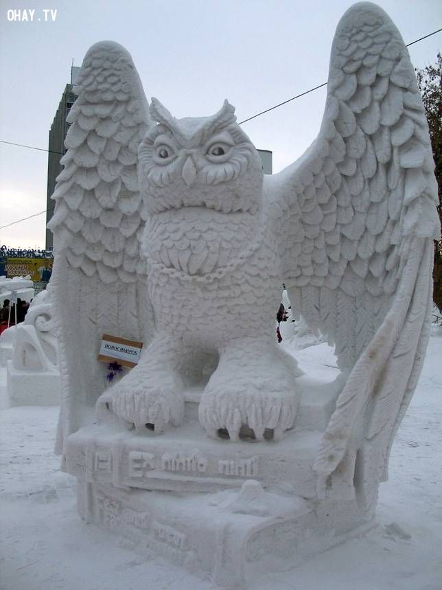 Intricate snow sculpture of an owl