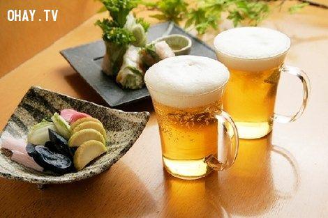 ảnh uống bia,tác dụng của bia,lợi ích của uống bia
