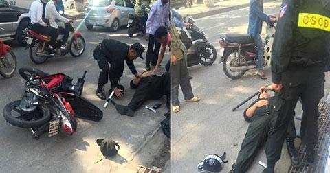 Xôn xao hình ảnh 1 cảnh sát cơ động bị xô ngã sõng soài ở Hà Nội