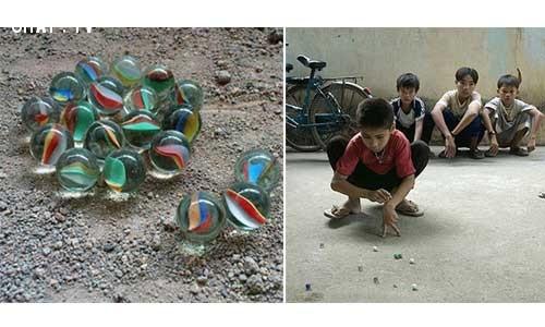 Bắn bi là trò chơi không thể thiếu của trẻ em,tuổi thơ dữ dội